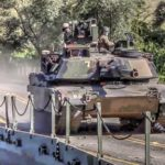 Army Armored Vehicles Conduct Tactical Water Crossing