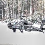 US Army AH-64 Helicopters Take Off in Snow