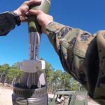 Marines ride on MV-22 and fire mortar and howitzer