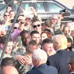 President Trump Arrives in Air Force One, Greets Servicemen.