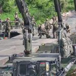 Troops Build Pontoon Bridge To Move Tanks Across River During NATO Drills In Lithuania
