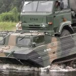 Polish Soldiers Use Soviet Era PTS Amphibious Vehicle To Carrie A Truck Across River