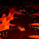 Intense And Dangerous Nighttime Flight Operations On Aircraft Carrier's Flight Deck