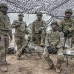 Army Paratroopers Conduct Fire Mission With M119 Howitzer